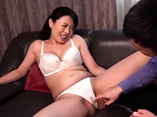 Mature whore sucking with an increment of fingering her young lover